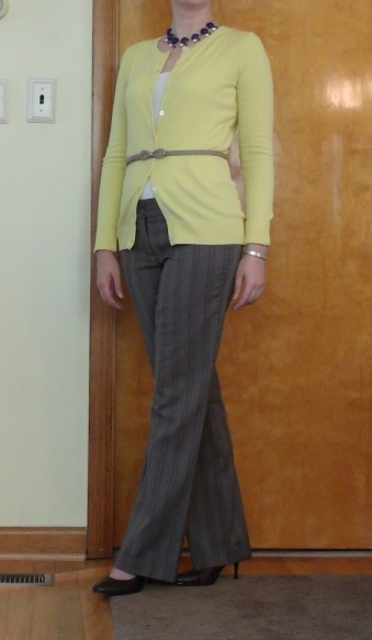 yellow cardigan and brown pinstriped dress pants